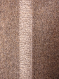 Grey/brown wool felt showing selvedge edge.