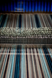 Close up of striped warp set up on loom for weaving